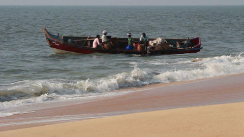 fishermen unload fresh catch of fish on beach - Ke Footage