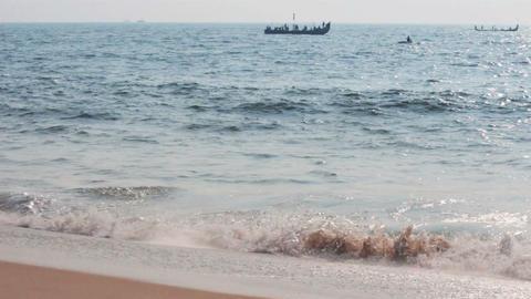fishermen boats in sea - Kerala India Footage