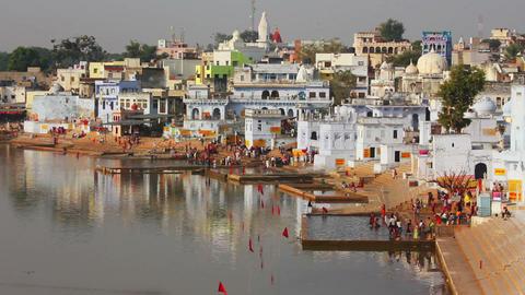 ritual bathing in holy lake Pushkar India - timela Footage