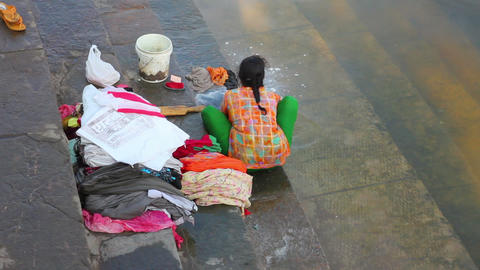 Indian woman washing clothes in the lake Footage