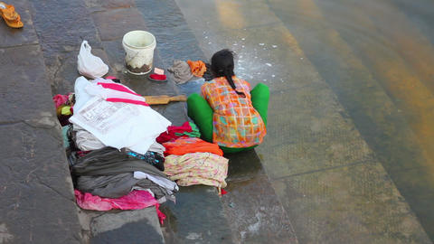 Indian woman washing clothes in the lake Stock Video Footage