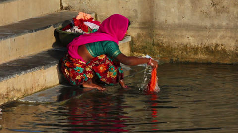 Indian woman with her daughter to wash clothes in  Footage