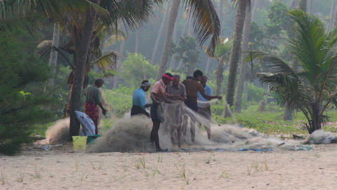 fishermans preparing fishnets for fishing - India Stock Video Footage