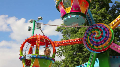 children ride on the carousel in the park Stock Video Footage