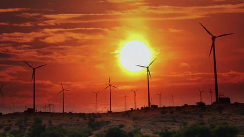 Wind Farm - Turning Windmills Against Timelapse Su stock footage