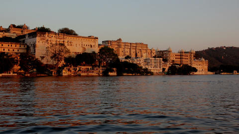 night follows day - palace on lake in Udaipur Indi Footage