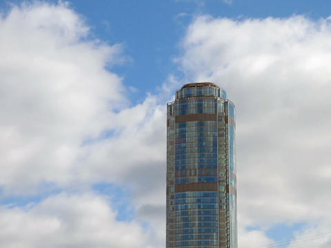 Skyscraper on a background of clouds. Time Lapse Footage