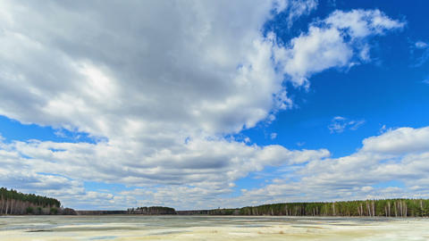 Clouds over the lake. Last snow. Fixed geometry Stock Video Footage
