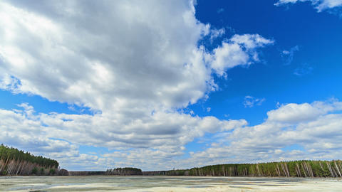 Clouds over the lake. Last snow Stock Video Footage