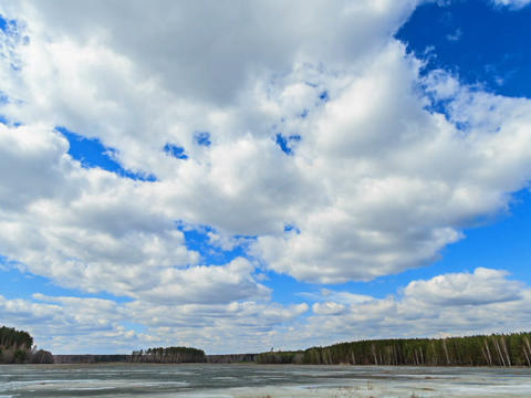 Clouds over the lake. Last snow. Time Lapse Stock Video Footage