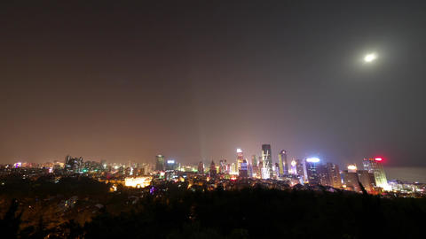 Time lapse of moon rising over urban skyline,china QingDao(tsingtao) Animation