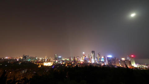 Time lapse of moon rising over urban skyline,china... Stock Video Footage