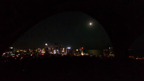 moon rising over urban skyline,china QingDao(tsingtao) Stock Video Footage