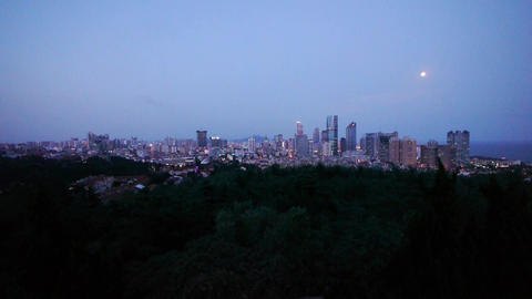 Time lapse of moon rising over urban skyline,day to night Stock Video Footage