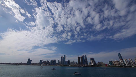 cloudscape & urban skyline,sailboat & yacht on sea Animation