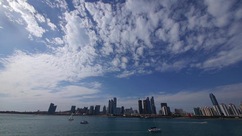 cloudscape & urban skyline,sailboat & yacht on sea Stock Video Footage