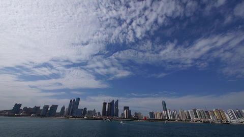 panoramic of cloudscape & urban skyline,sailboat & yacht on sea Animation