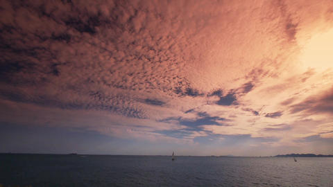 timelapse sailboat on sea,sunset clouds Animation