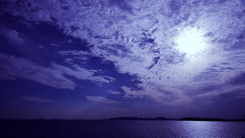 night clouds,moon light reflect on sea skyline Stock Video Footage