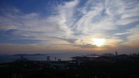 timelapse sunset clouds,seaside urban skyline & forest Animation