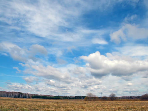Clouds over the field. Early Spring Footage