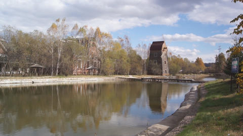 Windmill on the shore of the pond Stock Video Footage