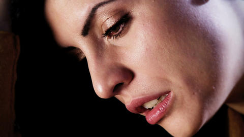 Sad desperate beautiful woman crying in the dark left... Stock Video Footage