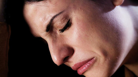 Sad desperate beautiful woman crying in the dark left alone closeup Animation
