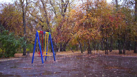 Swings in the park. It's snowing, Ekaterinburg, Ru Stock Video Footage