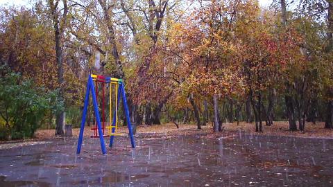 Swings in the park. It's snowing, Ekaterinburg, Ru Stock Video Footage