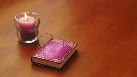 Romantic Book and Candle Stock Video Footage