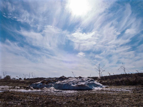 Pile of snow melts in the sun. Time Lapse. 4x3 Footage