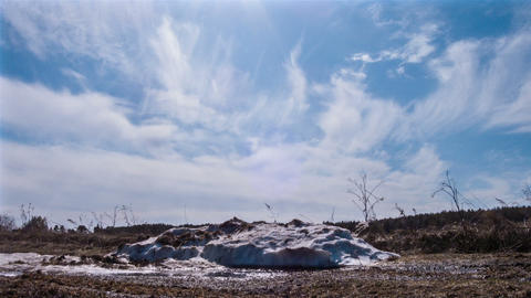 Pile of snow melts in the sun. Time Lapse Stock Video Footage