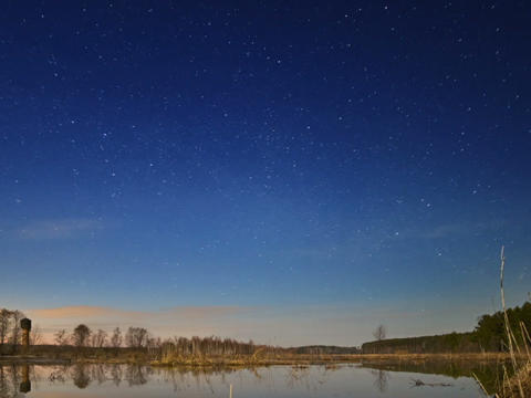 Sunset and starry sky reflected in lake. Fixed dis Stock Video Footage