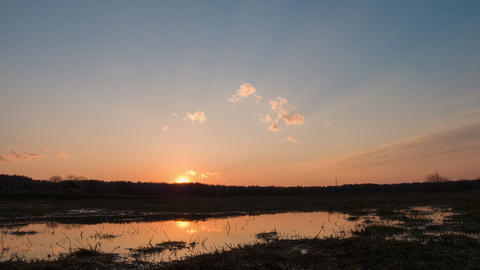 Sunset reflected in a puddle on the field Stock Video Footage