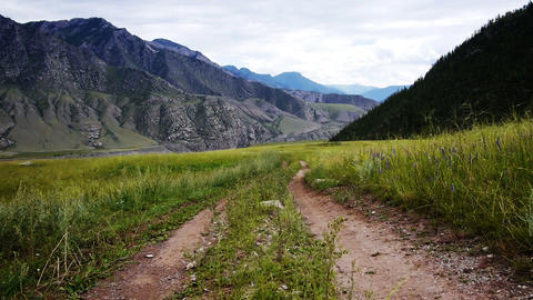 Dirt road in mountains Stock Video Footage
