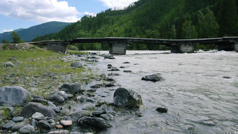 Old wooden bridge in mountains horizontal dolly tr Stock Video Footage
