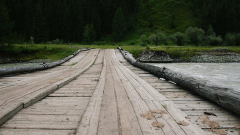 Old wooden bridge in mountains horizontal dolly tr Footage