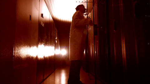 Scientist in data center in red Footage