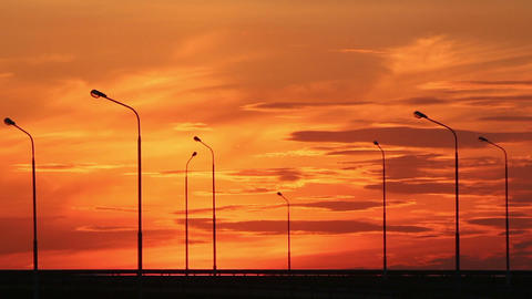 Cars silhouettes on road against sunset Footage