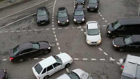 car traffic jam at intersection at rush hour - tim Stock Video Footage
