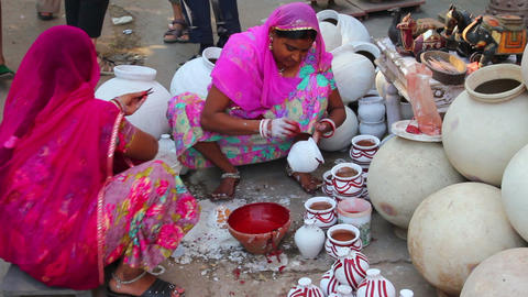 Women paint pots in the city market - Jodhpur Indi Footage