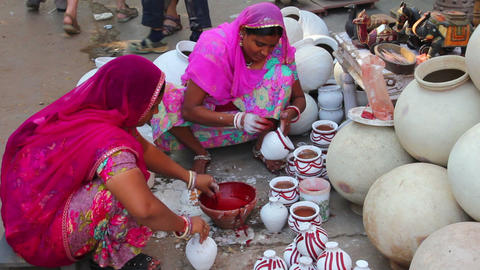 Women paint pots in the city market - Jodhpur Indi Stock Video Footage