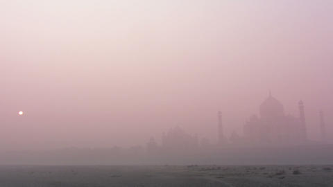Taj Mahal at sunrise in fog - timelapse Footage