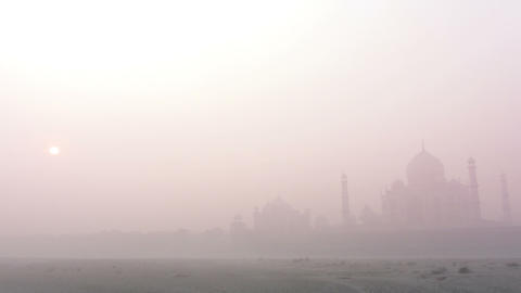 Taj Mahal at sunrise in fog - timelapse Stock Video Footage