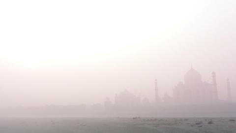 Taj Mahal at sunrise in fog - timelapse Stock Video Footage