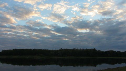 timelapse with evening clouds over lake Stock Video Footage