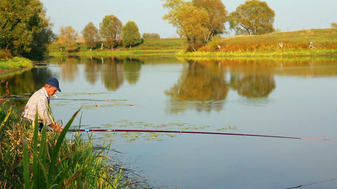 Fishing Senior On Autumn Lake stock footage