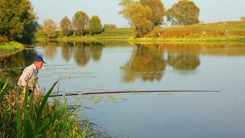 fishing senior on autumn lake Stock Video Footage