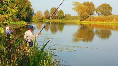 fishing senior couple on autumn lake - timelapse Stock Video Footage